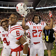 September 15, 2012 - Lexington, Kentucky, USA - WKU quarterback KAWAUN JAKES, #6, celebrates with team mates BAR'EE BOYD, left, and BEN AXON, right, after Western Kentucky University defeated the University of Kentucky, 32-31, on a trick play in overtime. (Credit Image: © David Stephenson/ZUMA Press).