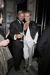 STEFANO PILATI and EVA HERZIGOVA  at a party for Yves Saint Laurent's Creative Director Stefano Pilati given by Colin McDowell held at The Connaught Bar, The Connaught, Mount Street, London on 29th October 2008.