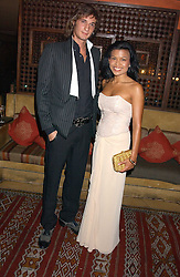 XAN MORGAN and HERSHEY PASCUAL at a dinner hosted by Ayesha Makim and leading stylist Mohieb Dahabieh to celebrate the forthcoming London Fashion Week held at the exotic restaurant Levant, 76 Wigmore Street, London W1 on 8th September 2005.<br />