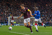 Christophe Berra (C) of Hearts under pressure from Sheyi Ojo of Rangers FC during the Betfred Scottish League Cup semi-final match between Rangers and Heart of Midlothian at Hampden Park, Glasgow, United Kingdom on 3 November 2019.