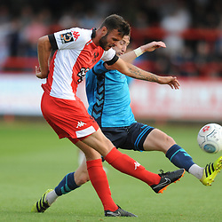 TELFORD COPYRIGHT MIKE SHERIDAN 7/8/2018 - Bily Daniels clears under pressure from James McQuilkin of AFC Telford during the National League North fixture between Kidderminster Harriers FC vs AFC Telford United.
