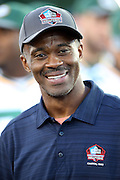 Former Indianapolis Colts wide receiver Marvin Harrison smiles as he walks onto the field as a new member of the Pro Football Hall of Fame before the 2016 NFL Pro Football Hall of Fame preseason football game against the Green Bay Packers on Sunday, Aug. 7, 2016 in Canton, Ohio. The game was canceled for player safety reasons due to the condition of the paint on the turf field. (©Paul Anthony Spinelli)