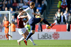Tottenham Hotspur's Harry Kane and Burnley's Jack Cork compete for possession