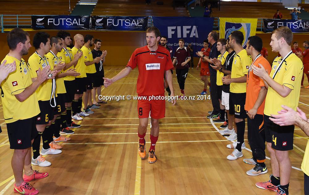 Mainland captain Daniel Burns celebrates winning the final. Mainland v Capital. Final of the 2014 National Futsal League, Series 3. ASB Stadium, Auckland, New Zealand. Sunday 7 December 2014. Photo: Andrew Cornaga/photosport.co.nz