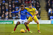 Jamal Lowe (10) of Portsmouth battles for possession with Ben Purrington (3) of AFC Wimbledon during the EFL Sky Bet League 1 match between Portsmouth and AFC Wimbledon at Fratton Park, Portsmouth, England on 1 January 2019.