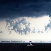 A severe thunderstorm forms over Raritan Bay in lower New York Harbor.