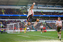 CARDIFF, WALES - Saturday, March 22, 2014: Liverpool's Luis Suarez celebrates scoring the fourth goal, the second of his hat-trick, against Cardiff City during the Premiership match at the Cardiff City Stadium. (Pic by David Rawcliffe/Propaganda)