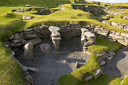Iron Age Pub.  <br /> UK SCOTLAND Jarlshof -- 23 Aug 2011 -- One of the best examples of an Stone Age (Neolithic) house (foreground) at the Jarlshof site near Sumburgh Head in the Shetland Islands of Scotland. This is thought to be the oldest house in the British Isles and is part of a complicated site which is thought to cover a period of sporadic habitation from 2500 BC to the 16th Century (the Laird's House visible as a ruin on the top right of this picture). The site also has Bronze and Iron Age buildings and also Pictish and Viking structures. The Bronze and Iron Age structures (visible in the upper left of this image) appear to be a larger, more complex building which was likely used as a sort of pub of it's day. *NB These images are attached to a story on the Iron Age Site.<br /> 23rd August 2011. Picture by Jonathan Mitchell / i-Images.