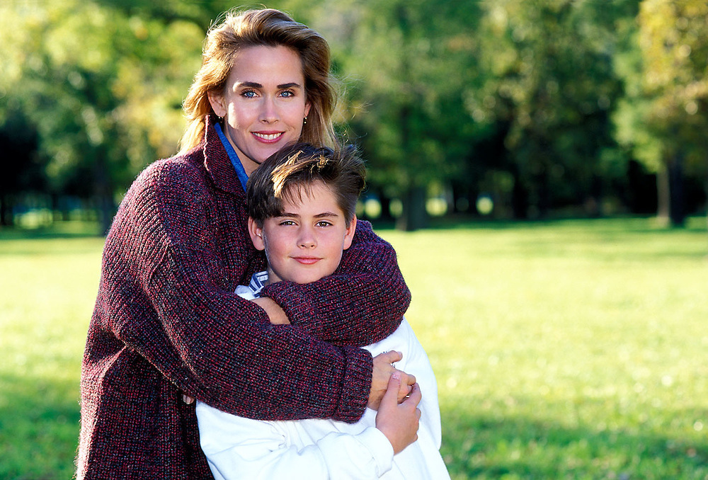 Portrait of mother and young son, outdoors, park setting.