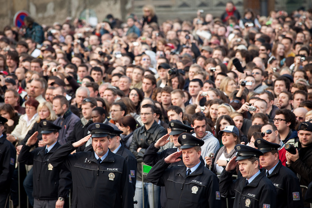 Czech policemen saluting during the Czech national anthem before Barack Obamas speech which took place on Sunday the 5th of April at Hradcanske square in front of Prague castle in Czech Republic.
