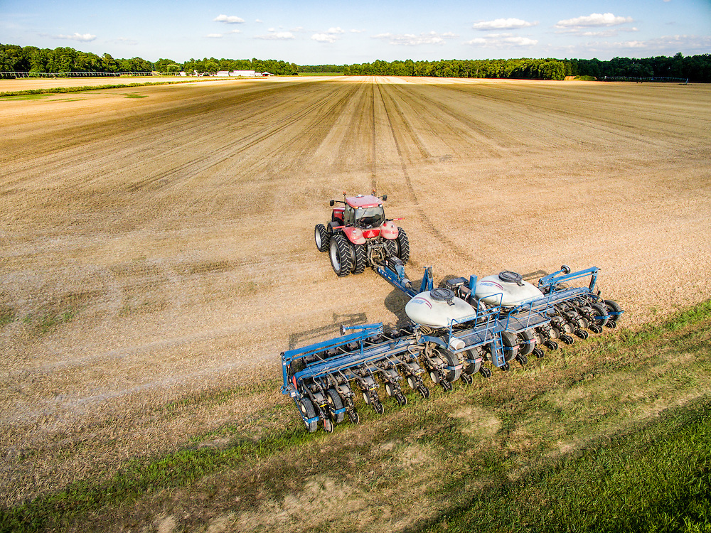 Aerial view of a planter moving through a field to double crop soy beans over wheat stubble.