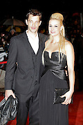 Bertrand Lacherie and Elodie Gossuin pose as they arrive at NRJ Music Awards 2012 at Palais des Festivals on January 28, 2012 in Cannes.Bertrand Lacherie et Elodie Gossuin posent à leur arrivée au NRJ Music awards 2012  au Palais des Festivals le Janvier 28 2012 à Cannes.