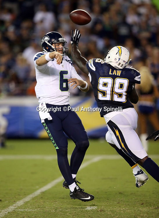 Seattle Seahawks quarterback R.J. Archer (6) throws a pass while pressured by San Diego Chargers linebacker Cordarro Law (99) during the 2015 NFL preseason football game against the San Diego Chargers on Saturday, Aug. 29, 2015 in San Diego. The Seahawks won the game 16-15. (©Paul Anthony Spinelli)
