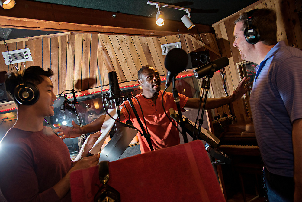GLENDALE, CA   July 30, 2017<br /> Former Skid Row resident Reginald Nelson, 44, has written and directed a fictional serial podcast called &quot;Red Sun&quot; about a modern day samurai vigilante in downtown Los Angeles. Nelson, center, spent Saturday at ES Audio Recording Studios working with actors Quinn Knox, 30, left, and Darin Munnell, 35, right. (Melissa Lyttle for The New York Times)