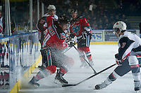 KELOWNA, CANADA - NOVEMBER 30: Tyson Baillie #24 of the Kelowna Rockets is checked at the boards by Braiden Doucette #7 of the Moose Jaw Warriors at the Kelowna Rockets on November 30, 2012 at Prospera Place in Kelowna, British Columbia, Canada (Photo by Marissa Baecker/Getty Images) *** Local Caption ***
