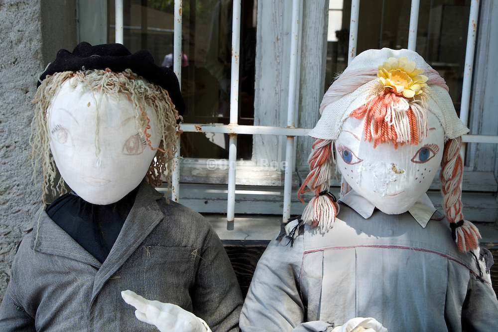 two dolls made to look like French elementary school children from turn of the century