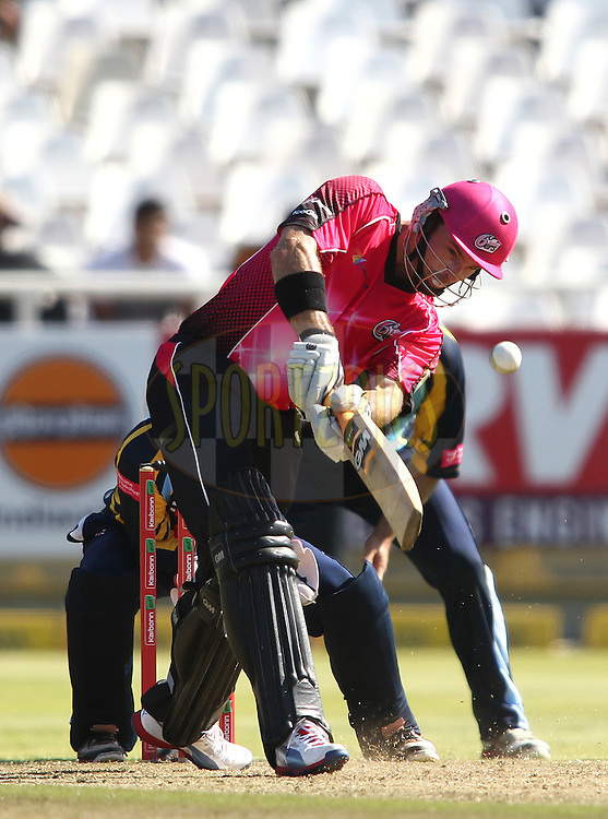Michael Lumb of the Sydney Sixers hits the winning runs as Sydney Sixers beat Yorkshire Carnegie during match 6 of the Karbonn Smart CLT20 South Africa between The Sydney Sixers and Yorkshire held at Newlands Stadium in Cape Town, South Africa on the 16th October 2012..Photo by Shaun Roy/SPORTZPICS/CLT20