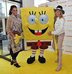 Left to right, SERENA REES, SpongeBob SquarePants and MAIA NORMAN at a party to launch a range of SpongeBob SquarePants suits and accessories designed by Richard James in partnership with Nickelodeon held at Richard James, 29 Savile Row, London W1 on 11th May 2011.