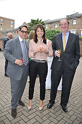 Left to right, TOMASZ STARZEWSKI, LADY MIRANDA HUTCHINSON and MIKE HUTCHINSON at a party to celebrate the launch of Bentley's The Collection held at 6 Square Rigger Row, Plantation Wharf, York Road, London SW11 on 25th June 2012.
