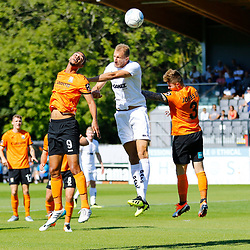 Dovers defender Tim Schmoll is kept in chewck by Barnets forward Byron Harrison and Barnets defender Elliot Johnson during the National League match between Dover Athletic and Barnet FC at Crabble Stadium, Kent on 1 September 2018. Photo by Matt Bristow.