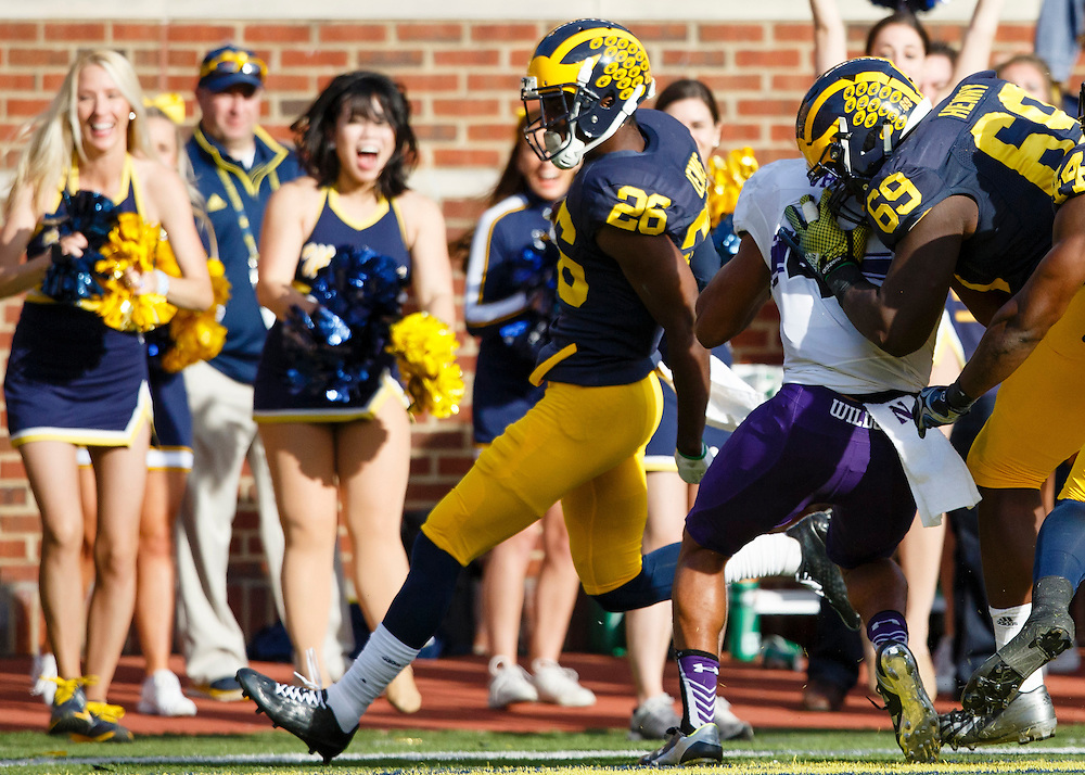 Oct 10, 2015; Ann Arbor, MI, USA; Michigan Wolverines cornerback Jourdan Lewis (26) scores a touchdown on an interception in the second quarter against the Northwestern Wildcats at Michigan Stadium. Mandatory Credit: Rick Osentoski-USA TODAY Sports