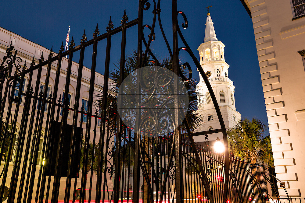 Steeple of St Michaels church at twilight at Meeting Street and Broad Street in historic Charleston, SC.