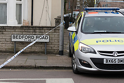 © Licensed to London News Pictures. 22/03/2017. LONDON, UK.  A police car and police officer at the east end of Bedford Road. A man has died after being shot in Ilford, east London. Police were called to reports of a shooting at the junction of Ilford Lane and Bedford Road in Ilford at 22:10 last night. Emergency services found the victim, a man unconscious with a gunshot wound and he died shortly after.  Photo credit: Vickie Flores/LNP
