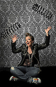 "Portrait of Rachel M. in studio juggling two large springs - ""Springs are in the Air"""