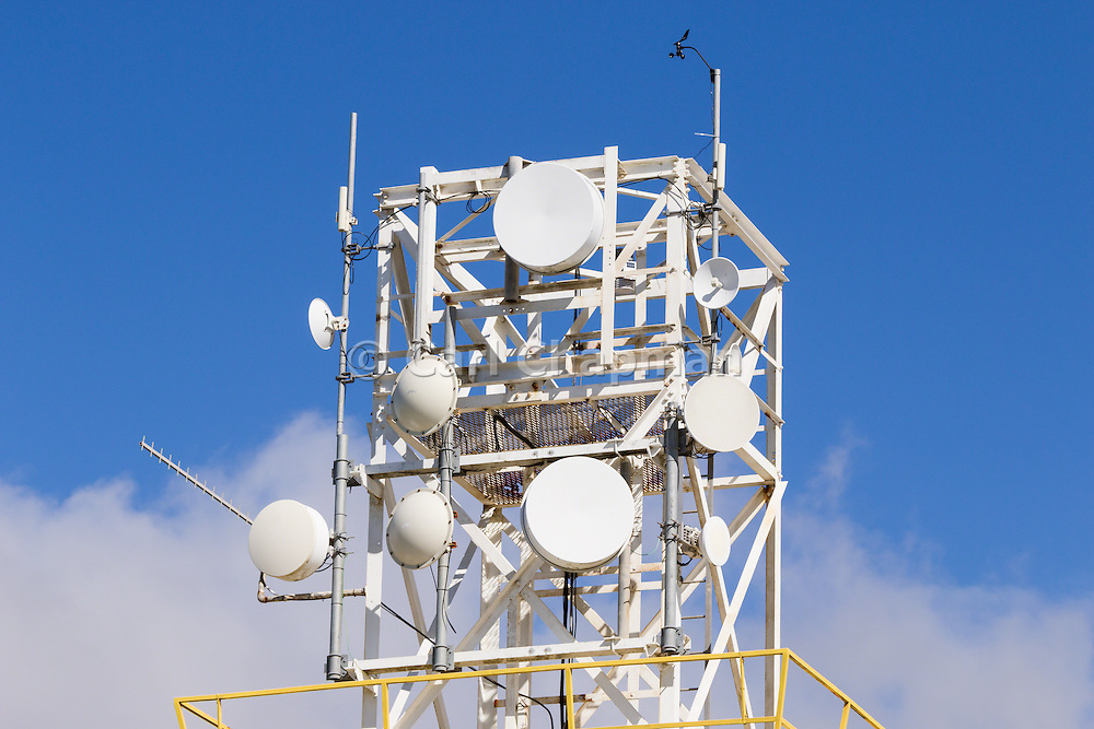 Microwave dish antenna on communications tower