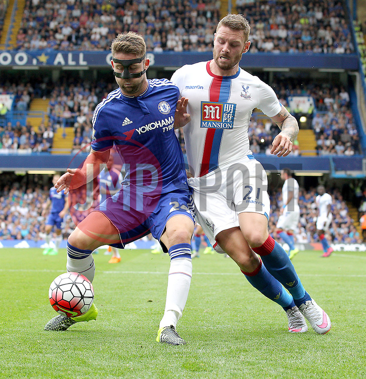 Gary Cahill of Chelsea and Connor Wickham of Crystal Palace challenge for the ball - Mandatory byline: Paul Terry/JMP - 07966386802 - 29/08/2015 - FOOTBALL - Stamford Bridge -London,England - Chelsea v Crystal Palace - Barclays Premier League