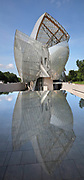 Fondation Louis Vuitton, with sails reflected in the pool, an art museum and cultural centre designed by Frank Gehry, b. 1929, and built 2008-14, next to the Jardin d'Acclimatation in the Bois de Boulogne, in the 16th arrondissement of Paris, France. The building resembles the sails of a boat and houses 11 galleries, an auditorium seating 350 and roof terraces. Picture by Manuel Cohen
