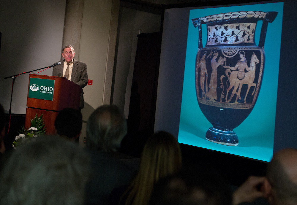 Ohio University Professor Tom Carpenter, the 2013 recipient of the Distinguished Professor Award, delivers a lecture about classical vases during the Distinguished Professor Lecture and award reception, held in Alden Library on Feb. 24, 2014. Photo by Lauren Pond