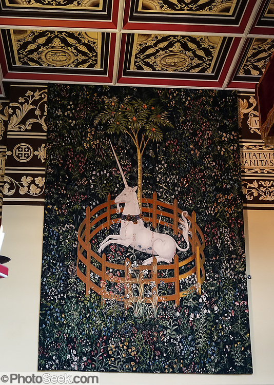"""""""Hunt of the Unicorn"""" replica tapestries in the Scottish Queen's Inner Hall in the Royal Palace at Stirling Castle, in Scotland, United Kingdom, Europe. The Royal Palace was childhood home of Mary Queen of Scots. The palace's lavish design drew on European Renaissance fashions to show off James V's power and good taste. Historic Scotland has recreated the palace interiors as they may have looked when the Scottish king's grand scheme was complete. The """"Hunt of the Unicorn"""" tapestries in the Queen's Lodgings are replicas hand-loomed from 2001-2014, inspired from the seven original tapestries made in Brussels between 1495-1505 (now in the Cloisters museum of New York's Metropolitan Museum of Art). Why a unicorn? In Celtic mythology the unicorn symbolized purity, innocence, masculinity and power. The proud, haughty unicorn was chosen as Scotland's national animal because it would rather die than be captured, just as Scots would fight to remain sovereign and unconquered. Once the capital of Scotland, Stirling is visually dominated by Stirling Castle. Most of Stirling Castle's main buildings date from the 1400s and 1500s, when it peaked in importance."""