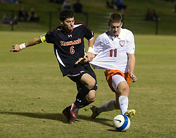 Virginia Cavaliers midfielder Jimmy Simpson (11) battles with Maryland Terrapins defender Rich Costanzo (6).  The Virginia Cavaliers fell to the Maryland Terrapins 2-1 in NCAA Soccer at Klockner Stadium on the Grounds of the University of Virginia in Charlottesville, VA on October 31, 2008.