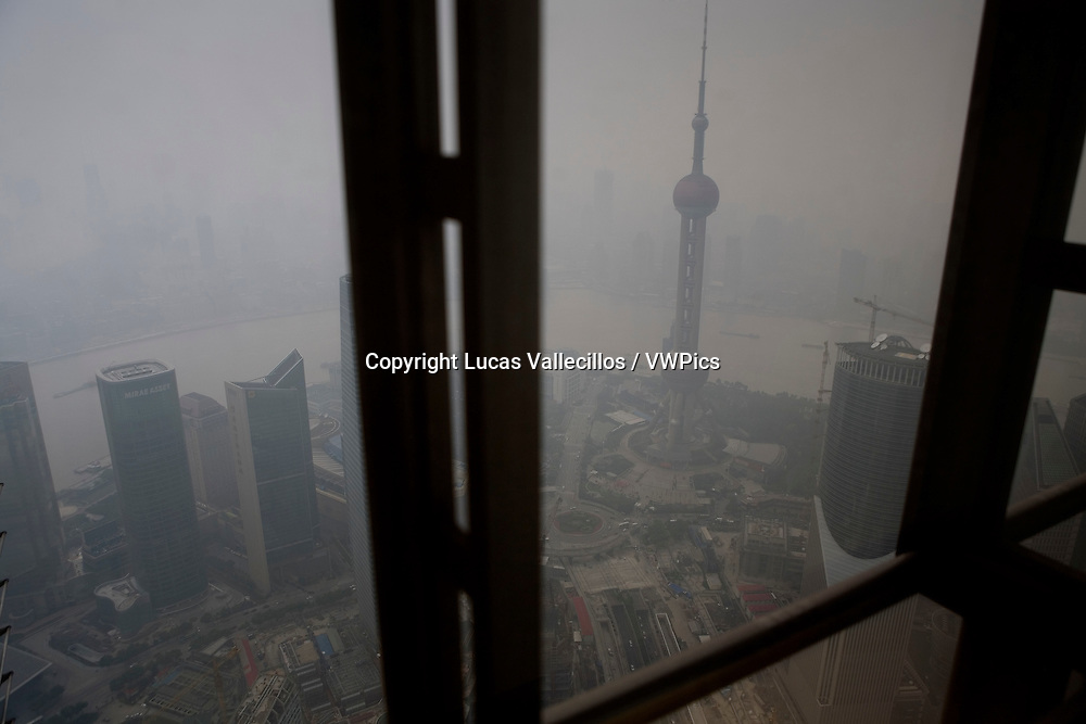 China.Shanghai: Very contaminated air. Pudong from Jin Mao Tower. At right Oriental Pearl Tower