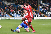 Bury Defender and loanee, Alex Whitmore (20) battles for possession with Milton Keynes Dons Midfielder, Gboly Ariyibi (7)  during the EFL Sky Bet League 1 match between Bury and Milton Keynes Dons at the JD Stadium, Bury, England on 30 September 2017. Photo by Mark Pollitt.