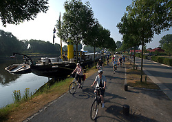 Tourists from Germany enjoy a Boat and Bike tour through Flanders. Members of the tour group depart Bruges for Damme, in the Flemish region of Belgium, on Sunday, July 11, 2010. (Photo © Jock Fistick)