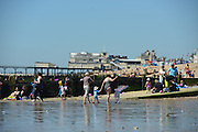 © Licensed to London News Pictures. 03/07/2014. Bognor Regis, UK People enjoy the hot sunny weather at the seaside resort of Bognor Regis today 3rd July 2014. Forecasters are predicting it to be the hottest day of 2014 so far. Photo credit : Stephen Simpson/LNP