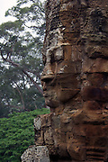 The self styled King Jayavarman VII likened his facial image to that of a buddhist ideal when having it carved and reproduced on the Bayon, Angkor Thom.