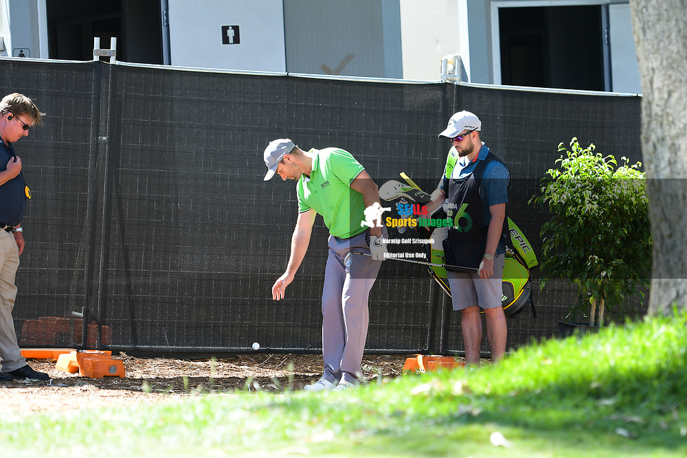 PERTH, AUSTRALIA - FEBRUARY 14: Oliver Wilson (ENG) getting relief on the 18th during the 1st round of the ISPS Handa World Super 6, Lake Karrinyup Country Club, Perth, Western Australia, on February 14, 2019. <br /> .<br /> .<br /> .<br /> (Photo by: Naratip Golf Srisupab/SEALs Sports Images)<br /> .<br /> Any image use must include a mandatory credit line adjacent to the content which should read: Naratip Golf Srisupab/SEALs Sports Images