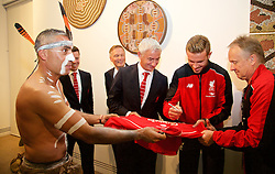 ADELAIDE, AUSTRALIA - Sunday, July 19, 2015: Liverpool's captain Jordan Henderson signs a shirt for Karl Winda Telfe of Aboriginal dance group Paitya during a visit to the Art Gallery of South Australia ahead of a preseason friendly match against Adelaide United on day seven of the club's preseason tour. (Pic by David Rawcliffe/Propaganda)