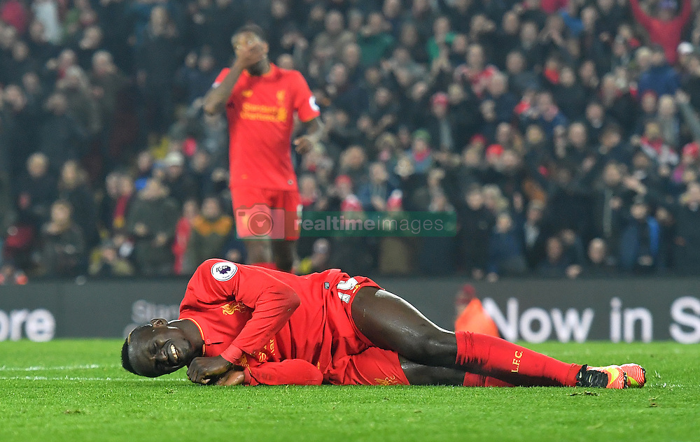 Liverpool's Sadio Mane lies on the ground after winning a penalty during the Premier League match at Anfield, Liverpool.