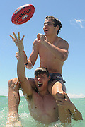 GOLD COAST, AUSTRALIA - NOVEMBER 19:  Jake & Kade (top) Kolodjashnij pose after a press conference ahead of the AFL Draft at Kurrawa Beach on November 19, 2013 on the Gold Coast, Australia.  (Photo by Matt Roberts/Getty Images)