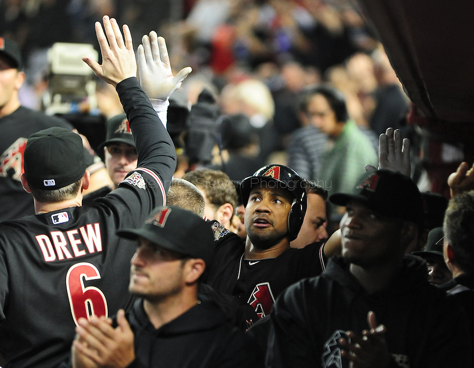 Oct. 5 2011; Phoenix, AZ, USA; Arizona Diamondbacks outfielder Chris Young (24) is congratulated by teammates after hitting a solo home run during the first inning against the Milwaukee Brewers at game four of the 2011 NLDS at Chase Field. Mandatory Credit: Jennifer Stewart-US PRESSWIRE.