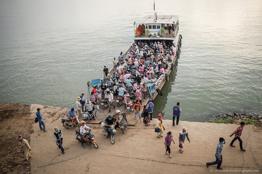 In the early morning, a ferry brings people from the other side of the Tonle Sap, to the centre of Phnom Penh, to their working places.
