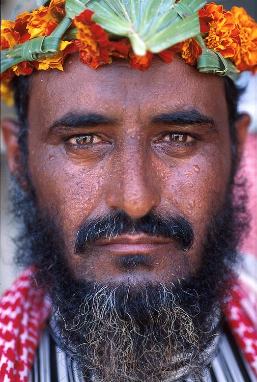 SAUDI ARABIA: Anha, Asir mountain region..Flower People: a portrait.