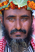 SAUDI ARABIA: Anha, Asir mountain region..Flower People: a portrait.