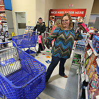 """Kimberly Card, of Eupora, gets a pair of Barbie tablets off the shelf as she enters Toys """"R"""" Us for early Black Friday shopping on Thursday afternoon. Card was one of the first 50 customers let into the store."""