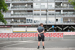 A Drops Cycling Team team mechanic checks out the finishing straight of Stage 1 of the Emakumeen Bira - a 50 km road race, starting and finishing in Iurreta on May 16, 2017, in Basque Country, Spain.