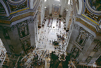 View of people from catwalk in dome of St Peters Basilica Vatican City Rome Italy